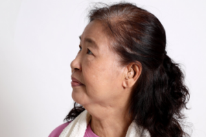 Woman using hearing Aid